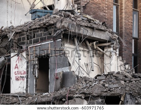 Demolition site, details of a large building being destroyed.  #603971765