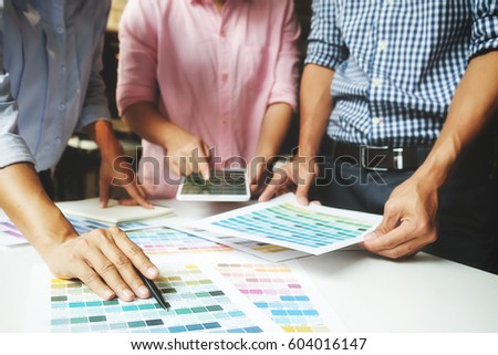 Graphic design and color swatches and pens on a desk. Architectural drawing with work tools and accessories selective focus. #604016147