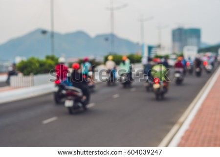 Blurred picture of motorcycles on the road. #604039247