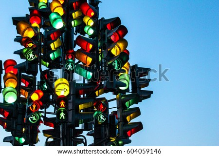 Traffic light tree with a lot of lamps under sky with a sunset. Royalty-Free Stock Photo #604059146