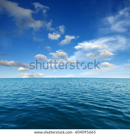 Blue sea water surface on sky #604095665