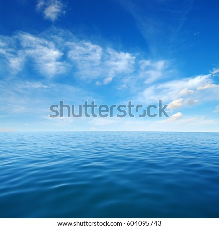 Blue sea water surface on sky #604095743