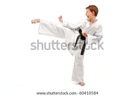 Young boy training karate. Isolated on white background #60410584