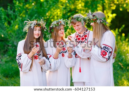 Midsummer. A group of young people of Slavic appearance at the celebration of Midsummer. #604127153