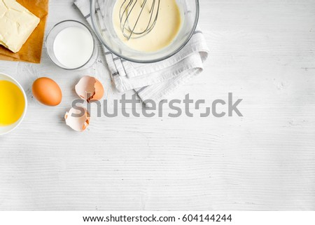 cooking pancake on white background top view ingredients for making #604144244