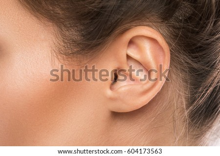 Close up of female ear Royalty-Free Stock Photo #604173563