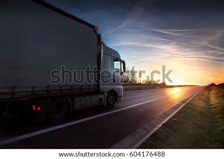 Truck transportation at sunset #604176488