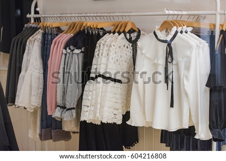 Women clothes on racks in a store in London. #604216808