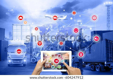 Hand holding tablet is pressing button on touch screen interface in front Logistics Industrial Container Cargo freight ship for Concept of fast or instant shipping, Online goods orders worldwide Royalty-Free Stock Photo #604247912