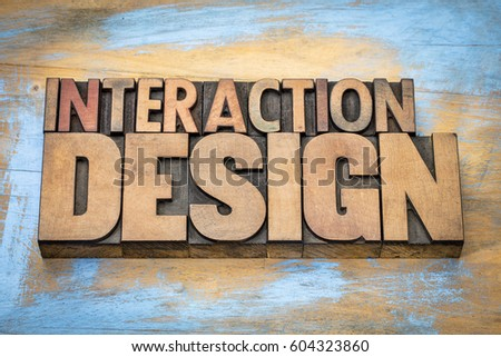interaction design - designing interactive digital products, environments, systems, and services - word abstract in vintage letterpress wood type against grunge wooden background #604323860