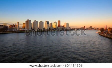 Rotterdam skyline and the river Meuse at sunset , the Netherlands #604454306