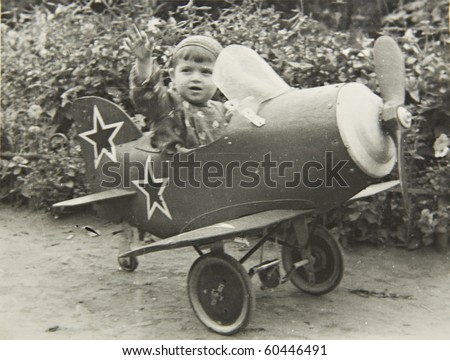 A little boy on the plane, an old picture of 40 years of XX century.
