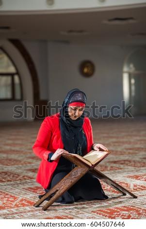 Muslim woman reading #604507646