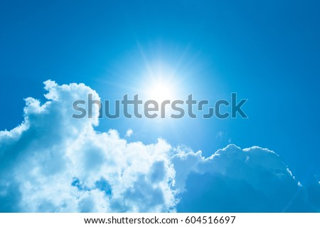 Sunshine and clouds with a blue, blue sky. Royalty-Free Stock Photo #604516697