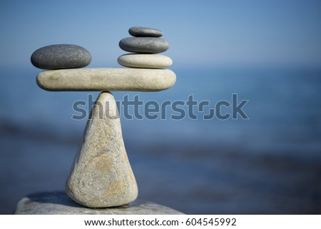 Balance of stones. To weight pros and cons. #604545992