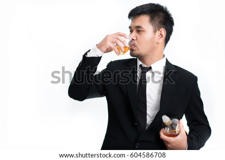 drunk business man holding whiskey bottle with alcoholism problem. Modern person looking messy with alcohol abuse and addiction concept. Isolated on white backgroud with blank copy space #604586708