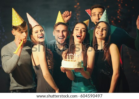 Friends having fun at birthday party in night club Royalty-Free Stock Photo #604590497