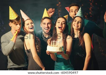 Friends having fun at birthday party in night club