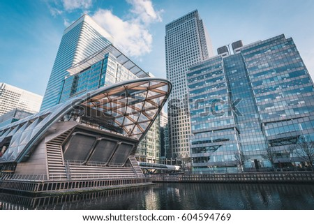 LONDON, UK - MARCH, 2016: Low-angle shot of the Canary Wharf. It is a major business district located in Tower Hamlets, East London. It is one of the United Kingdom's two main financial centres #604594769