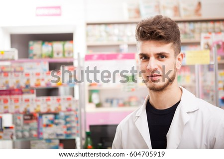 Pharmacist man in front of his desk at work. healthcare business #604705919