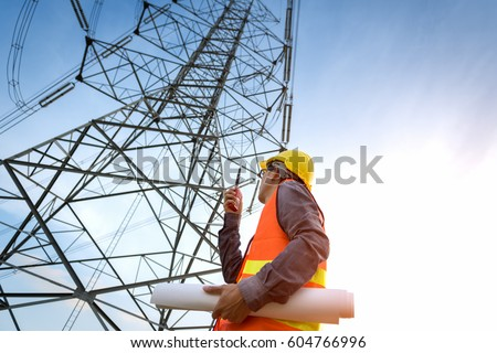 construction worker checking location site near to High voltage tower. #604766996