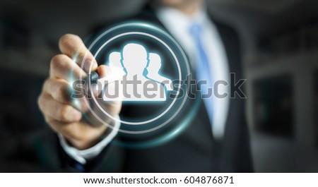 Businessman on blurred background using blue social network 3D rendering #604876871