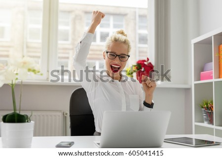 Business woman celebrating with hands up