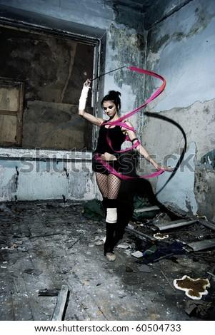 Young ballerina woman inside empty grunge room #60504733