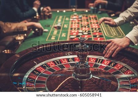 Gambling table in luxury casino. Royalty-Free Stock Photo #605058941