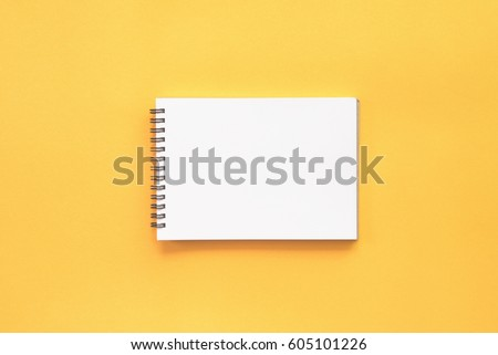 Blank notebook on yellow background. Royalty-Free Stock Photo #605101226