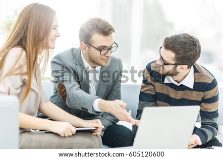 managers of the company and the client, discussing the terms of the new contract and look at the laptop screen with the correct information. Royalty-Free Stock Photo #605120600