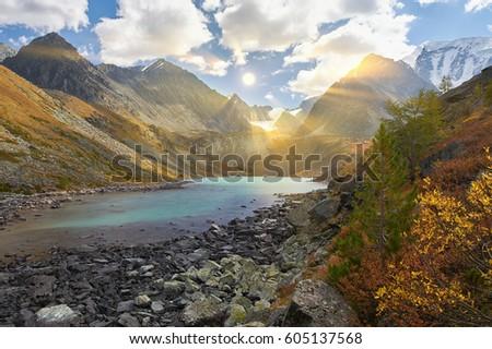 Sun among the mountain peaks. Beautiful summer landscape, mountain lake, Russia, Siberia, Altai mountains, Katun ridge. #605137568