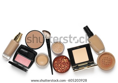 Make-up cosmetics set of liquid and cream foundations, compact and loose powder in various tones, bronzing pearls, blush and brush isolated on white background. Top view point. #605203928