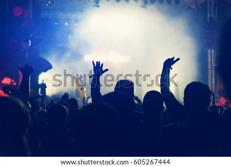 Rear view of crowd with arms outstretched at concert #605267444