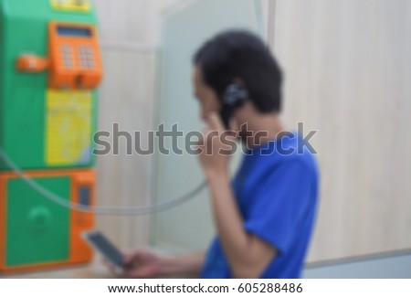 Abstract blurred asian men use public phone  #605288486