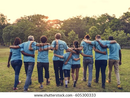 Group of diversity people volunteer arm around Royalty-Free Stock Photo #605300333