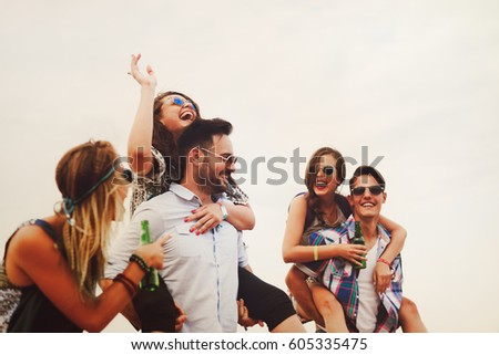 Group of friends having fun outdoors and are happy #605335475