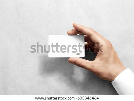 Hand hold blank white loyalty card mockup with rounded corners. Plain vip mock up template holding arm. Plastic discount namecard display front. Gift offset card design. Loyal service branding. #605346464