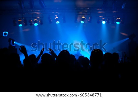 Crowd at popular music concert. Blurred image.  #605348771