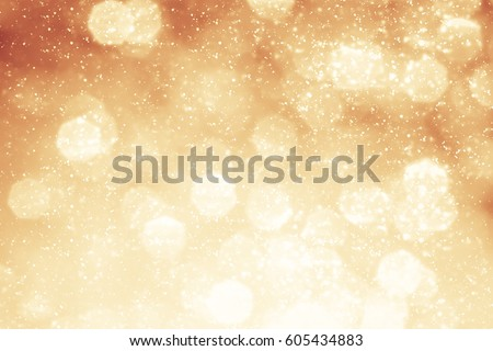 Magic Festive blue background. Abstract bokeh light and red sunlight. Christmas glitter