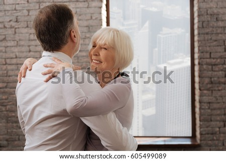 Smiling senior couple tangoing in the dance studio #605499089
