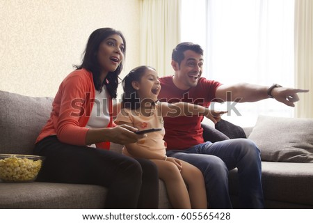 Excited family pointing at television  #605565428