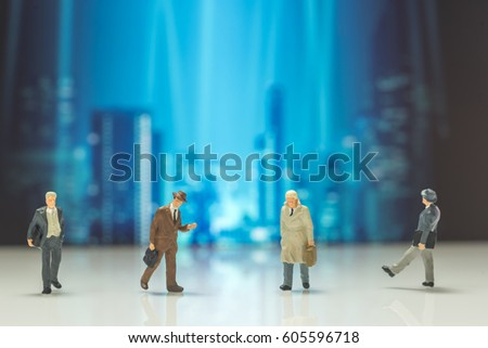 business miniature people on night modern city background #605596718