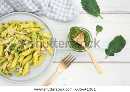Plate of pasta and pesto of radish green on an old white wooden background #605641301