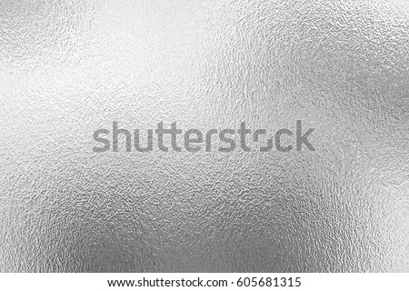 Shiny metal silver foil texture for background. Royalty-Free Stock Photo #605681315