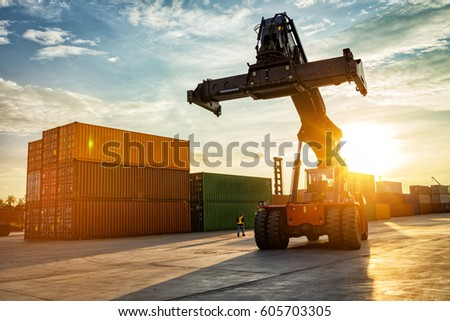 Thailand Laem Chabang Chonburi Industrial logistic forklift truck containers shipping cargo in port at sunset time. #605703305