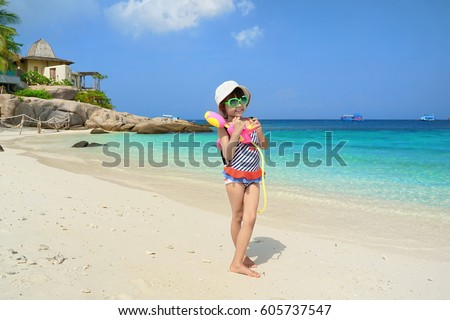 Children play in the sand at the beach.Kids playing water gun.Summer sea travel.Summer beach travel.  Royalty-Free Stock Photo #605737547