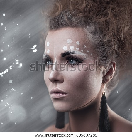 Art makeup. Beauty female portrait with cute make-up #605807285