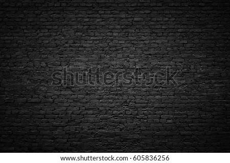gloomy background, black brick wall of dark stone texture #605836256