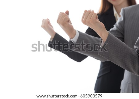 Businessman and business woman doing guts pose, 3 people #605903579